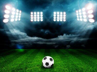 Poster Esfera de futebol no campo do estádio com luz