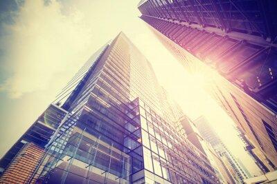 Poster Foto do estilo do vintage dos arranha-céus em Manhattan ao pôr do sol.