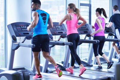 Poster Group of people running on treadmills