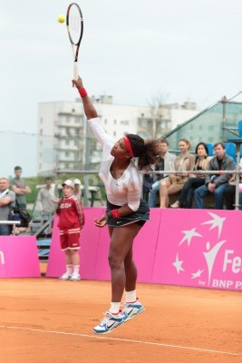 Poster KHARKOV, UKRAINE - APRIL 22, 2012: Serena Williams serve a ball during Fed Cup tie between USA and Ukraine in Superior Golf and Spa Resort, Kharkov, Ukraine at April 22, 2012