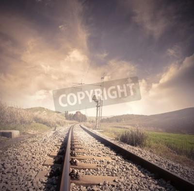 Poster Longa estrada de ferro no nascer do sol