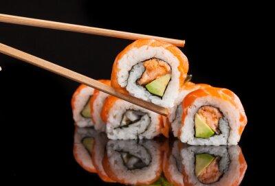 Poster Maki sushi served on black background