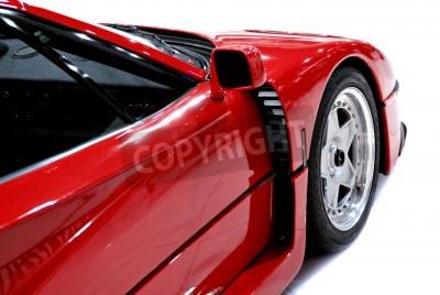 Poster O fim lado e da frente de um carro esportivo vermelho