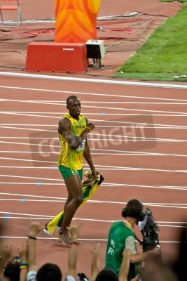 Poster Pequim, China - 16 de agosto de 2008: campeão olímpico Usain Bolt Sprinter após a vitória em 100 metros corrida olímpica