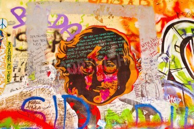 Poster PRAGUE, CZECH REPUBLIC - SEPTEMBER 11, 2014: Famous John Lennon Wall on Kampa Island in Prague is filled with Beatles inspired graffiti and pieces of lyrics since the 1980s. Graffities are drawn on da