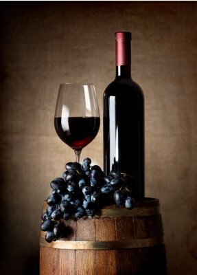 Poster Red wine with barrel and grapes