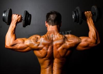 Poster retrovisor de formação fisiculturista com halteres no fundo preto