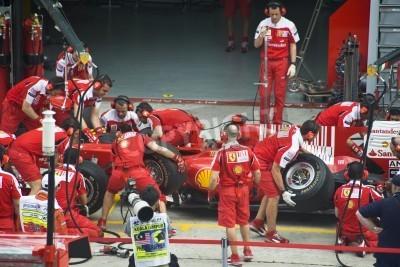 Poster Sepang F1 Circuit, Malaysia - April 2, 2010 - The crew of Scuderia Ferrari Marlboro F1 racing team practicing tyres change during Petronas Malaysian Grand Prix 2010 April 2-4, Sepang.