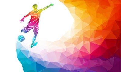 Poster Silhueta criativa do jogador de futebol. O jogador de futebol retrocede a esfera na parte traseira colorida abstrata na moda do arco-íris do polígono