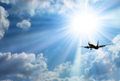 Poster Silhueta do avião com um céu bonito