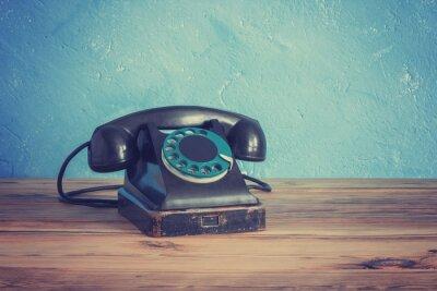 Poster Vintage telefone em uma mesa de madeira