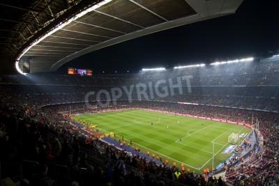 Poster BARCELONA, ESPANHA - 13 de dezembro de 2010: Vista panorâmica do Camp Nou, o estádio do time de Football Club Barcelona, antes do jogo FC Barcelona - Real Sociedad, contagem final 5-0 a.