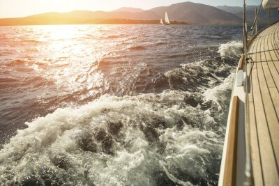 Poster Yacht, sea overboard, sailing regatta during sunset.