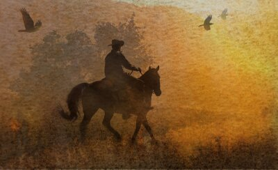 Quadro A dramatic design of a cowboy and his horse riding in a meadow into the sunset with crows flying above.  A mixed media piece of artwork in photography and watercolor.