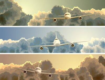 Quadro Bandeira horizontal do avião entre nuvens.