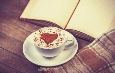 Quadro Chávena de café e livro com lenço