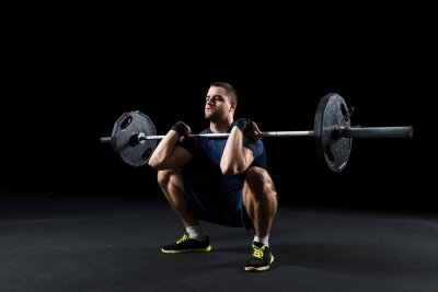 Quadro Crossfit athlete performs  weight lift