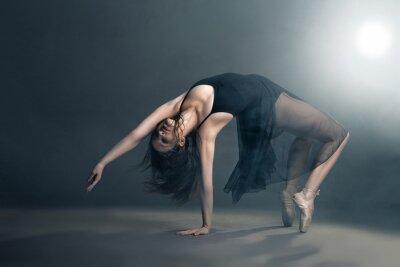 Quadro Dançarino moderno do estilo que levanta no fundo cinza