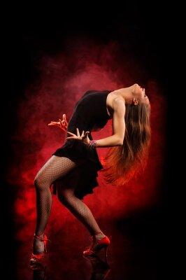 Quadro Dançarino moderno do estilo que levanta no fundo escuro