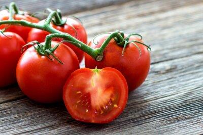 Quadro Fresh tomatoes on wood background