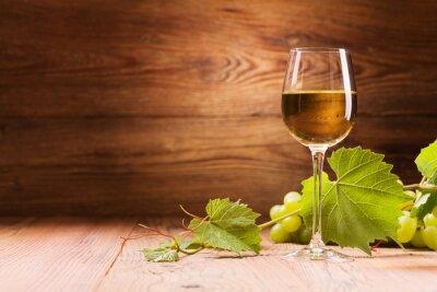 Quadro Glass of white wine.