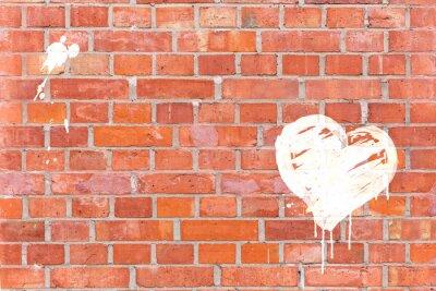 Quadro Graffiti coração rendeu em uma parede de tijolo com espaço para texto