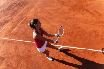Quadro Jogador de ténis fêmea que serve uma bola de tênis