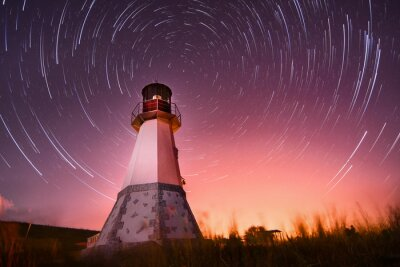 Quadro lighthouse with night sky at background stars trails