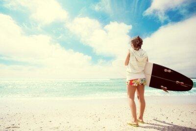 Quadro Menina do surfista na praia