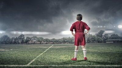 Quadro Menino do miúdo no campo de futebol