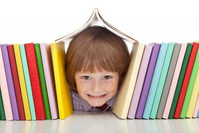 Quadro Menino feliz com livros coloridos
