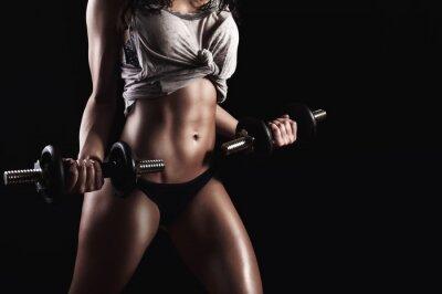 Quadro Mulher da aptidão no treinamento duro