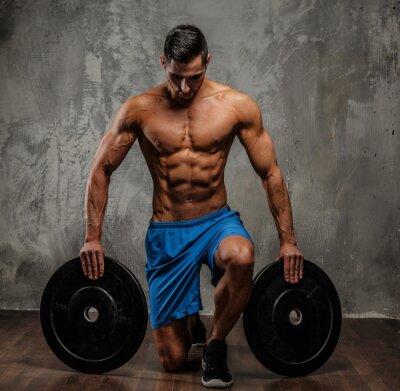 Quadro Muscular guy in blue shorts