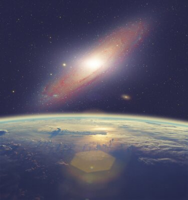 Quadro Nascer do sol sobre a Terra com grande galáxia de Andrômeda.