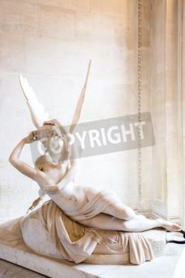 Quadro Paris - 23 de junho: Estátua de Cupido em 23 de junho de 2014, em Paris. Estátua Psique de Antonio Canova Revived pelo beijo do Cupido, primeiro comissionado em 1787, exemplifica a devoção Neoclassica