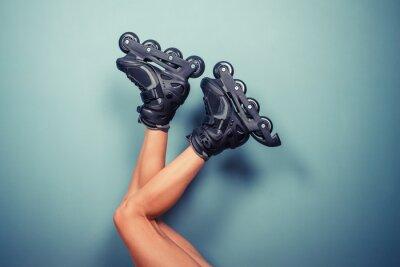 Quadro Pernas de mulher vestindo patins
