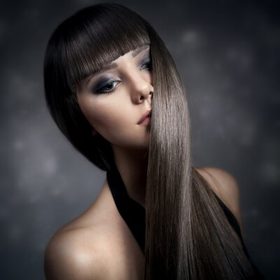 Quadro Portrait of a beautiful brunette woman with long straight hair