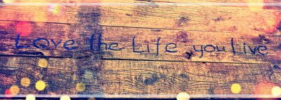 Quadro Positive inspiring quote written carved  in wood Love the life you live. Best motivational quotes, inspirational quotes and sayings about life. Motivation, and inspiration image quote
