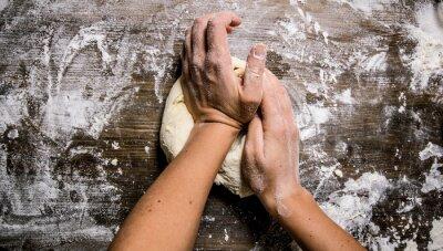 Quadro Preparação da massa. Preparação da massa as mãos das mulheres.