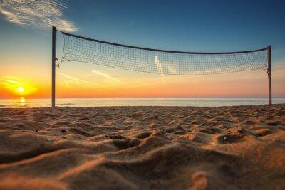 Quadro Rede de voleibol e nascer do sol na praia