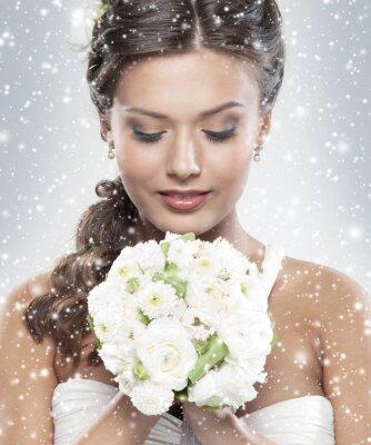 Quadro Retrato de uma jovem noiva segurando um buquê de flores