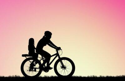 Quadro Silhueta Mãe anda de bicicleta com a filha no amanhecer borrado