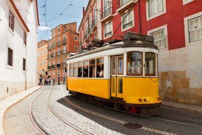 Quadro tram on narrow street of Alfama, Lisbon