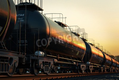 Quadro Transporte carros-tanque com óleo durante o pôr do sol.