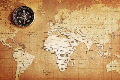 Quadro Um compasso de bronze velho em um fundo do mapa do tesouro