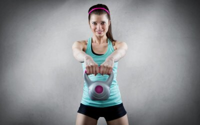 Quadro Young woman kettlebell workout